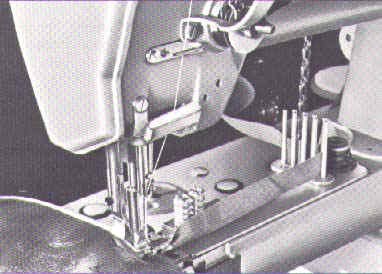 Cylinder arm machine with binder